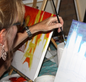 Photo of Susan Esbrook painting at a Smock Party in Chicago