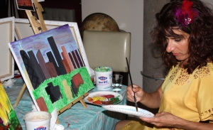 Yianna Angelopoulos helping a student with her Chicago skyline.