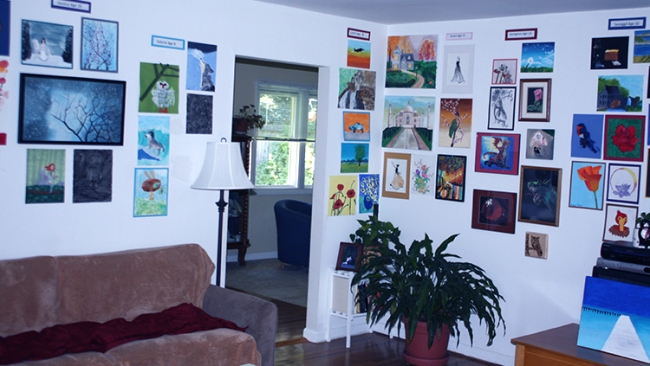 Photograph of Christy Alden's living room displaying her students'artworks