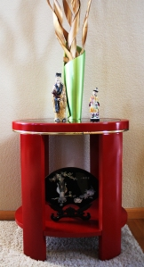 Photo of Attractive Spray-Painted Table with Asian Knickknacks